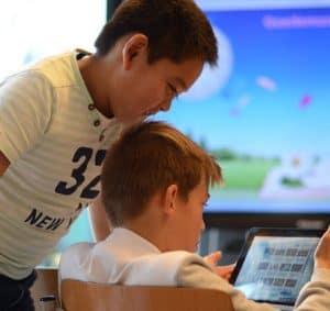 two boys laptop