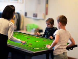 children playing games on screen
